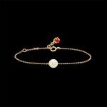 bracelet naissance or, perle serti d'un saphir blanc